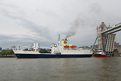 © Licensed to London News Pictures. 07/06/2016. LONDON, UK.  The Royal Mail Ship, St Helena arrives in London under Tower Bridge on the River Thames on her final call to London before she is decommissioned next month. St Helena is one of two remaining ocean-going Royal Mail Ships and was built in 1989 to supply the island of St Helena, a remote British Overseas Territory located 1,200 miles off the West Coast of Africa in the South Atlantic. The RMS St Helena currently serves to carry post and cargo to the remote island, but is to be decommissioned as a postal vessel this year as an airport is being built on the island to replace it.  Photo credit: Vickie Flores/LNP