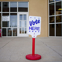 A sign marks the McKinley County Courthouse in Gallup as an early voting location Thursday.