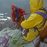 ROCK CLIMBING, Yosemite, El Capitan. Jay Jensen & Doug Robinson (MR) rappel from rainy bivouac halfway up Nose route during February, 1978.
