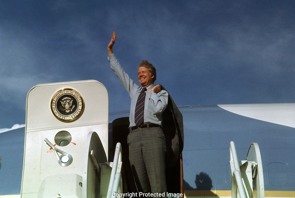 A 28 MG IMAGE OF:.The Carter Years.  .President Jimmy Carter waves before departing on Air Force One.Photo by Dennis Brack B 2