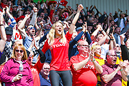 Charlton Athletic fans celebrate Lyle Taylor of Charlton Athletic (9) scoring a goal to make the score 1-0 during the EFL Sky Bet League 1 play off first leg match between Doncaster Rovers and Charlton Athletic at the Keepmoat Stadium, Doncaster, England on 12 May 2019.
