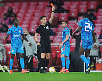 Football - 2020 / 201 UEFA Europa League - Round 16 - Second Leg - Arsenal vs Olympiakos - Emirates Stadium<br /> <br /> Ousseynou Ba of Olympiakos receives the red card from referee, Carlos Del Cerro Grande<br /> <br /> <br /> Credit : COLORSPORT/ANDREW COWIE
