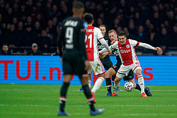 Dusan Tadic #10 of Ajax and Dani de Wit #10 of AZ Alkmaar in action during the Dutch Eredivisie match round 25 between Ajax Amsterdam and AZ Alkmaar at the Johan Cruijff Arena on March 01, 2020 in Amsterdam, Netherlands