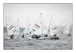 The second day of racing at the World Laser Radial Youth Championships, Largs, Scotland...Busy windward mark with Akira Hanada JPN 193631..317 Youth Sailors from 42 different nations compete in the World and European Laser Radial Youth Champiponship from the 17-25 July 2010...The Laser Radial World Championships take place every year. This is the first time they have been held in Scotland and are part of the initiaitve to bring key world class events to Britain in the lead up to the 2012 Olympic Games. ..The Laser is the world's most popular singlehanded sailing dinghy and is sailed and raced worldwide. ..Further media information from .laserworlds@gmail.com.event press officer mobile +44 7866 571932 and +44 1475 675129 .