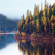 Fall colors reflect on Salmon Lake, Montana.