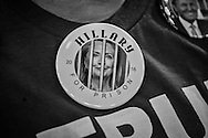 A Donald Trump fan wearing an anti-Hillary Clinton button  at a campaign rally in Baton Rouge, LA, for Republican presidential candidate Donald Trump, before he arrives, on Feb. 11, 2016.