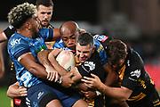 Hoskins Sotutu (L) and Mark Telea tackle Rob Kearney.<br /> Blues v Force, Sky Super Rugby Trans-Tasman. Eden Park, Auckland. New Zealand. Saturday 12 June 2021. © Copyright Photo: Andrew Cornaga / www.photosport.nz