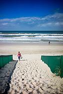 Female figure walking on the beach in Australia