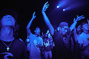 TRUSSVILLE, AL - AUGUST 27, 2013: Baylen Clough (left) and Chris Frias (right) worship at The Basement, a Christian youth ministry in Alabama that is widely known for its club atmosphere and large crowds. Clough and Frias are both Birmingham natives and have been attending The Basement for several years. The service was the first to be held since The Basement's founder Matt Pitt was arrested for impersonating a police officer on August 20, 2013. CREDIT: Bob Miller for The New York Times.