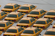 A fleet of taxis sit submerged in downtown Hoboken, New Jersey, Tuesday, October 30, 2012.  Photographer: Emile Wamsteker/Bloomberg News