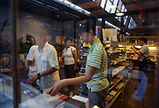 People look at books in a Dashanzi art book shop (not timezone 8).