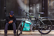 A delivery man takes a break near Oxford Street in London on Thursday, May 28, 2020. The government in Britain eased restrictions across England as a slow loosening of the coronavirus lockdown gets underway, with people now encouraged to return to work if unable to do so from home and unlimited outdoor exercise now allowed. As the row over Prime Minister Boris Johnson's top aide Dominic Cummings' Durham trip, continues, the prime minister's populist appeal has been hammered by the news and members of the public who have seen the evidence and believe that PM Johnson's chief adviser Cummings flouted lockdown rules that the government had imposed on the rest of the country by driving 250 miles (400 kilometres) to his parents' house while he was falling ill with suspected COVID-19. (Photo/ Vudi Xhymshiti)