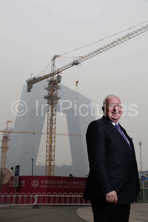Sam Walsh, chief executive officer of Rio Tinto, poses for photographs, with the China Central Television (CCTV) tower in the background in Beijing, China on 01 November 2013. China accounts for almost 30 percent of Rio Tinto's sales