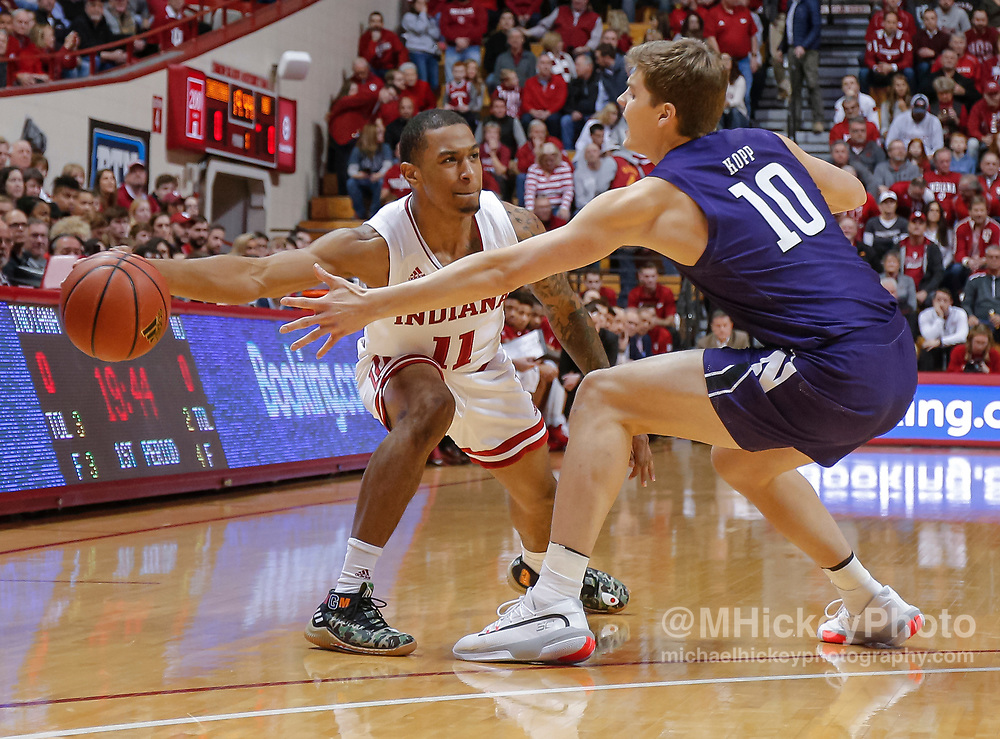 BLOOMINGTON, IN - JANUARY 08: Devonte Green #11 of the Indiana Hoosiers passes the ball off against Miller Kopp #10 of the Northwestern Wildcats at Assembly Hall on January 8, 2020 in Bloomington, Indiana. (Photo by Michael Hickey/Getty Images) *** Local Caption *** Devonte Green; Miller Kopp