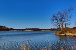 04 April 2015:   Spring at Dawson Lake located in Moraine View State Park maintained by the Illinois Department of Natural Resources (IDNR) near Le Roy Illinois before the trees leaf out.<br /> <br /> Image was shot with a perspective corrective lens to sweeten the focal points.<br /> <br /> This image was produced in part utilizing High Dynamic Range (HDR) processes.  It should not be used editorially without being listed as an illustration or with a disclaimer.  It may or may not be an accurate representation of the scene as originally photographed and the finished image is the creation of the photographer.