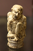 Carved ivory figure of a hunch-back displaying the symptoms of Pott's Disease. Perhaps made in Alexandria in the 1st century Bc