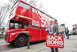 © licensed to London News Pictures. London, UK 27/02/2012. A mayor of London Boris Johnson look-like poses next to an old Routemaster bus as a 'Sack Boris' protest team holds a protest against the high bus fairs and new hop-on, hop-off double decker bus services in London. London's newly designed hop-on, hop-off double decker bus services begin today 27th February 2012 as the first bus leaves Hackney Bus Garage this morning. Photo credit: Tolga Akmen/LNP