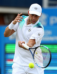 Luxembourg's Gilles Muller in action against Croatia's Marin Cilic during day six of the 2017 AEGON Championships at The Queen's Club, London.