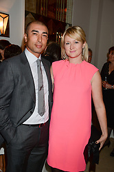 """Footballer ROBERTO DI MATTEO and his wife ZOE at an """"Evening With Damon Hill'  a dinner and talk in aid of the Downs Syndrome Association held at Claridge's, Brook Street, London on 7th November 2013."""