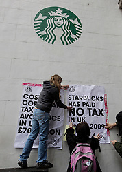 © Licensed to London News Pictures. 08/12/2012. London, U.K..Protesters at two branches of Starbucks coffee shops in regents street central london today (8/12/12), over their corporation tax affairs..Photo credit : Rich Bowen/LNP
