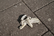 Surgical gloves discarded on the streets is a new phenomenon due to the Coronavirus pandemic, as seen here in Kings Heath on 13th April 2020 in Birmingham, England, United Kingdom. Coronavirus or Covid-19 is a new respiratory illness that has not previously been seen in humans. While much or Europe has been placed into lockdown, the UK government has put in place more stringent rules as part of their long term strategy, and in particular social distancing.