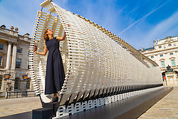 Nassia Inglessis, Lead Designer and Engineer poses with Greece's entry to the London Design Biennale, Disobedience', a 17 metre-long wall constructed from a steel spring skeleton built up with recycled plastic which flexes, morphs and breathes around the human body. dominates the courtyard at Somerset House.<br /> <br /> A highlight of the global design calendar, London Design Biennale will see some of the world's most exciting and ambitious designers, innovators and curators gather in the capital to show how design impacts our very being and every aspect of our lives. <br /> <br /> This year, London Design Biennale takes place from 4-23 September at Somerset House. In response to the theme Emotional States, 40 countries, cities and territories from six continents will exhibit engaging and interactive design installations across the entirety of Somerset House. In an exhibition of outstanding ideas and creativity, international design teams will illustrate how design can challenge, delight, educate and surprise. London, September 03 2018.