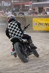 One-armed Hooligan flattracker (no. 23) Jason Griffin in the Hooligan races on the temporary track in front of the Sturgis Buffalo Chip main stage during the Sturgis Black Hills Motorcycle Rally. SD, USA. Wednesday, August 7, 2019. Photography ©2019 Michael Lichter.