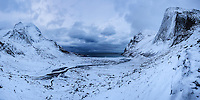 Stormy winter skies over snow covered Bunes beach, Moskenesøy, Lofoten Islands, Norway