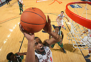 Nov. 15, 2010; Charlottesville, VA, USA; Virginia Cavaliers forward Mike Scott (23) shoots a basket above USC Upstate Spartans defenders during the game at the John Paul Jones Arena. Virginia won 74-54. Mandatory Credit: Andrew Shurtleff