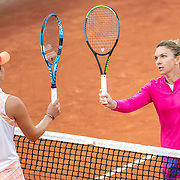 PARIS, FRANCE September 30. Winner Simona Halep of Romania is congratulated at the net by Irina-Camelia Begu of Romania in the second round of the singles competition on Court Suzanne Lenglen during the French Open Tennis Tournament at Roland Garros on September 30th 2020 in Paris, France. (Photo by Tim Clayton/Corbis via Getty Images)