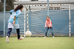 20 February 2020, Za'atari Camp, Jordan: A girl shoots a penalty during football practice for girls in the Peace Oasis, a Lutheran World Federation space in the Za'atari Camp where Syrian refugees are offered a variety of activities on psychosocial support, including counselling, life skills trainings and other activities.