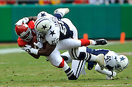 October 11, 2009:   Linebacker Bradie James #56 of the Dallas Cowboys takes down wide receiver Bobby Wade #80 of the Kansas City Chiefs after making a catch in the second quarter at Arrowhead Stadium in Kansas City, Missouri.  The Cowboys defeated the Chiefs in overtime 26-20...