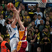 Fenerbahce Ulker's Oguz Savas (L) during their Turkish Basketball league derby match  Fenerbahce Ulker between Galatasaray at Sinan Erdem Arena in Istanbul, Turkey, Friday, December 30, 2011. Photo by TURKPIX