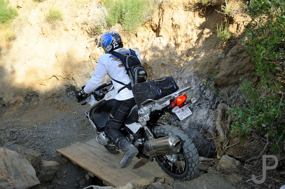 """Riders had to cross makeshift bridges during """"The Pit"""" competition at the 2009 Rawhyde Adventure Rider's Challenge in Castaic, CA."""