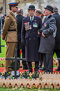 Old soldiers pay their respects and chat to the current generation - The Duke of Edinburgh, Life Member, Royal British Legion, accompanied by Prince Harry, visit the Field of Remembrance at Westminster Abbey  - 10 November 2016, London.