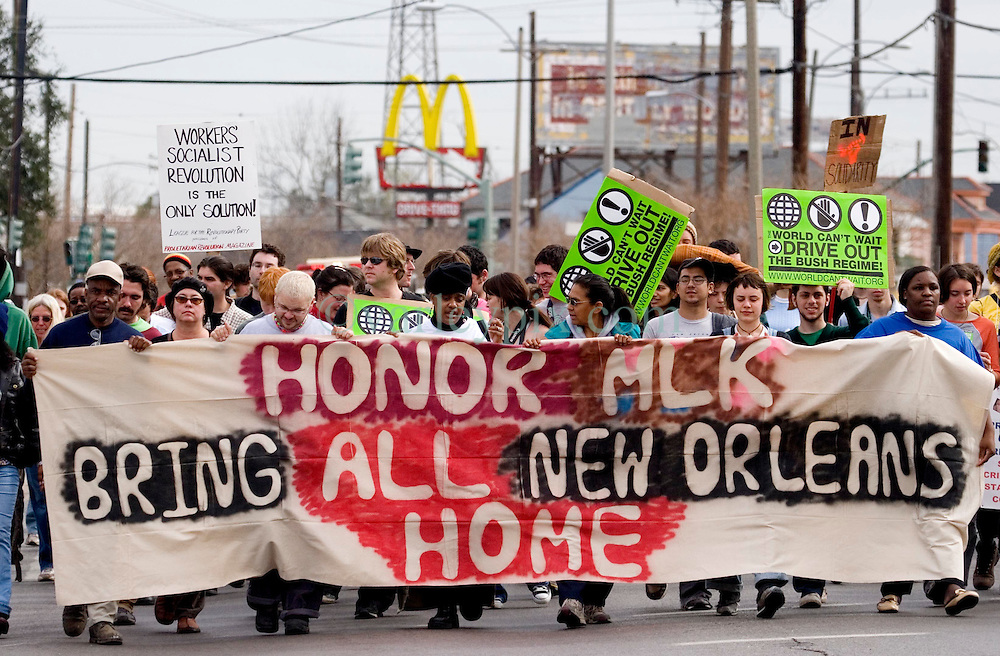 16 Jan, 2006. New Orleans, Louisiana. Post Katrina.<br /> Martin Luther King Jr parade. The C3/Hands off Iberville coalition march almost 6 miles from the devastated Lower Ninth Ward to downtown New Orleans in an alternative protest to the Mayor's officially sanctioned celebrations marking Martin Luther King Jr day. The protest remembered those who perished and claims to stand up for the rights of displaced, primarily african americans.<br /> Photo; Charlie Varley/varleypix.com