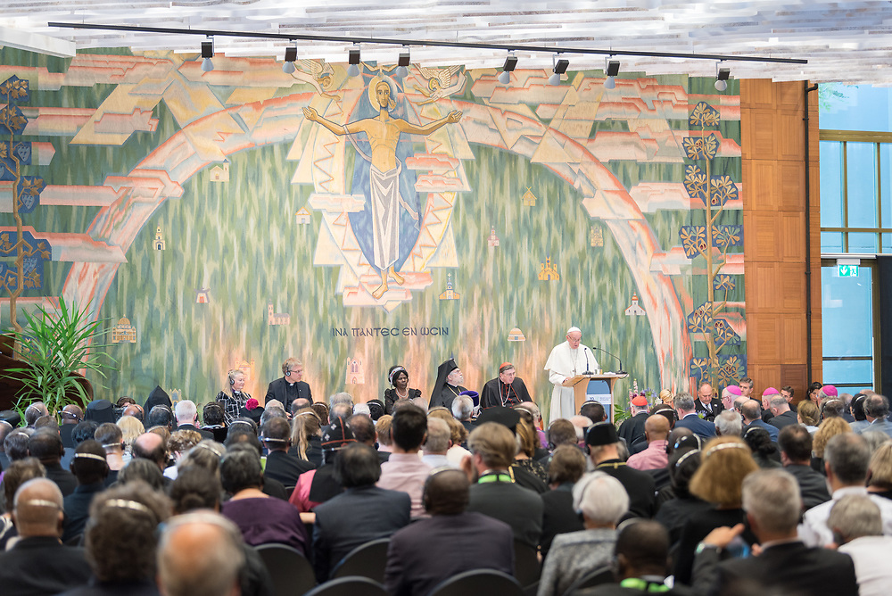 """21 June 2018, Geneva, Switzerland:  Pope Francis speaks at an Ecumenical Encounter between Pope Francis and the World Council of Churches on 21 June. On 21 June 2018, the World Council of Churches receives a visit from Pope Francis of the Roman Catholic Church. Held under the theme of """"Ecumenical Pilgrimage - Walking, Praying and Working Together"""", the landmark visit is a centrepiece of the ecumenical commemoration of the WCC's 70th anniversary. The visit is only the third by a pope, and the first time that such an occasion was dedicated to visiting the WCC."""