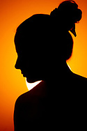 Silhouette of a woman with a bun