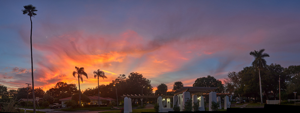 Colorful clouds after sunset. Andalusia Plaza in Granada Terrace. Historic Northeast St. Petersburg, Florida. Composite of 9 images taken with a Leica CL camera and 23 mm f/2 lens (ISO 100, 23 mm, f/2.8, 1/60 sec). Raw images processed with Capture One Pro and AutoPano Giga Pro.