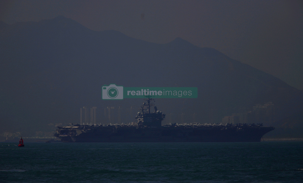 November 21, 2018 - Hong Kong, CHINA - USS RONALD REAGAN  ( CVN-76 ), a Nimitz-class, nuclear powered supercarrier of the United States Navy anchored down at western zone of the Victoria Harbour Hong Kong this morning amidst the political / trading tension between China and the United States.Nov-21,2018 Hong Kong.ZUMA/Liau Chung-ren (Credit Image: © Liau Chung-ren/ZUMA Wire)