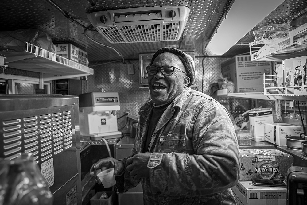 Washington, D.C- Saidu, 55-year old from West Africa has his ice-cream van on the streets of Washington, D.C. He loves to watch old Bollywood films. He laughs explaining a scene in one of the recent movies he saw. Photograph captured on 27th Jan 2019.