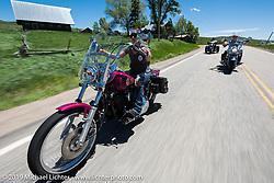 Kizaray Edumunds of Chanhassen, MN on her 1993 Softail Custom riding the 20 Mile Road in Steamboat Springs during the Rocky Mountain Regional HOG Rally, Colorado, USA. Saturday June 10, 2017. Photography ©2017 Michael Lichter.