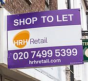 Shop to let HRH Retail estate agency sign, Newbury, Berkshire, England, UK