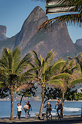 Early morning exercise along Ipanema beach and Two Brothers Mountain early morning in Rio de Janeiro, Brazil.