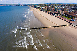 Portobello, Scotland, UK. 5 May 2020.  Warm sunny weather at Portobello but the promenade and beach remained quiet with only a few families and people exercising venturing onto the sand. Pictured; Aerial view of Portobello beach. Iain Masterton/Alamy Live News