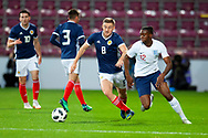 Allan Campbell (#8) of Scotland U21s (Motherwell FC) and Aaron Wan-Bissaka (#12) of England U21s (Crystal Palace) during the U21 UEFA EUROPEAN CHAMPIONSHIPS match between Scotland and England at Tynecastle Stadium, Edinburgh, Scotland on 16 October 2018.