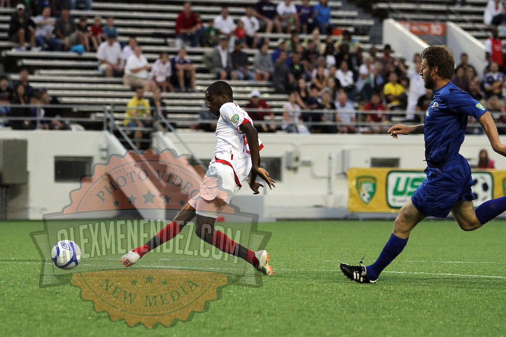 Orlando City Lions Midfielder Kevin Molino (18) scores a goal during a United Soccer League Pro soccer match between the Pittsburgh Riverhounds and the Orlando City Lions at the Florida Citrus Bowl on May 14, 2011 in Orlando, Florida. Orlando won the game 1-0. (AP Photo/Alex Menendez)