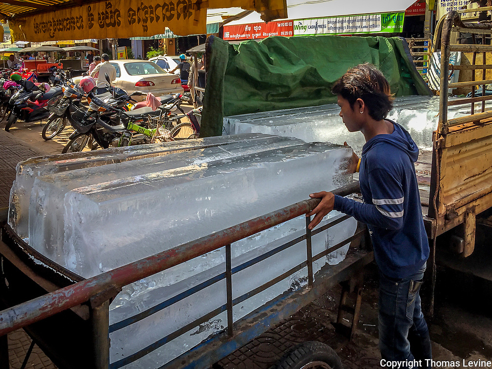 Block Ice in Siem Reap being loaded from the freezer. iPhone Filtered frozen ice block and bags are delivered to many restaurants in Asia.