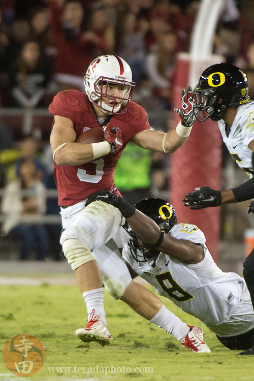 November 14, 2015; Stanford, CA, USA; Stanford Cardinal running back Christian McCaffrey (5) runs with the football against Oregon Ducks defensive back Reggie Daniels (8) during the second quarter at Stanford Stadium. The Ducks defeated the Cardinal 38-36.