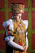 Birka-Marie, member of the 'Trachtengruppe Lindhorst' is wearing an original  traditional bridal costume in Lindhorst, Lower Saxony, Germany on December 5, 2016.<br /> <br /> The traditional costumes of Lindhorst are also part of the Schaumburg costumes with its origins in Spanish Fashion of the second half of the 1600s.<br />  <br /> Only pristine women were allowed to wear the bridal crown.<br /> <br /> This is part of the series about Traditional Wedding Gowns from different regions of Germany, worn by young members of local dance groups and cultural associations that exist to preserve and celebrate the cultural heritage. The portraiture series is a depiction of an old era with different social values and religious beliefs in an antiquated civil society with very few of those dresses left.